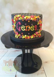 Black cake with flowers