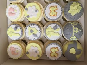 grey and yellow baby shower cupcakes